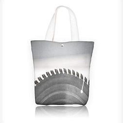 Canvas Tote Bags wood plunge saw blade against blurred backg